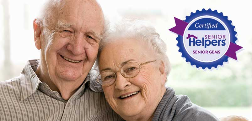 An elderly couple smiling